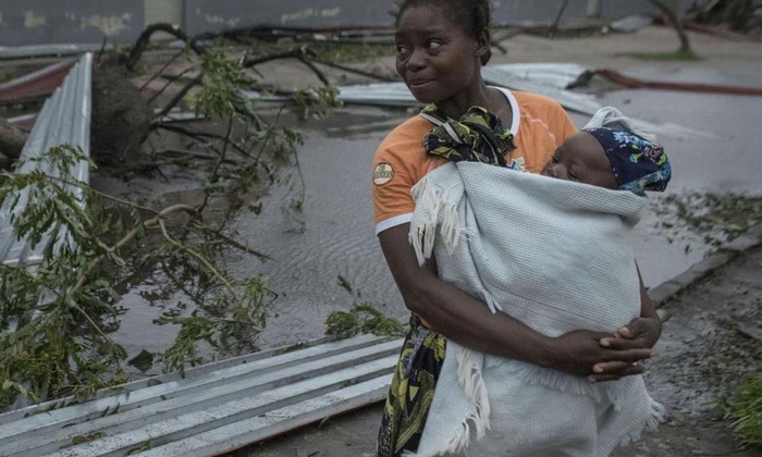 Women holding child after Cyclone Idai in Southern Africa