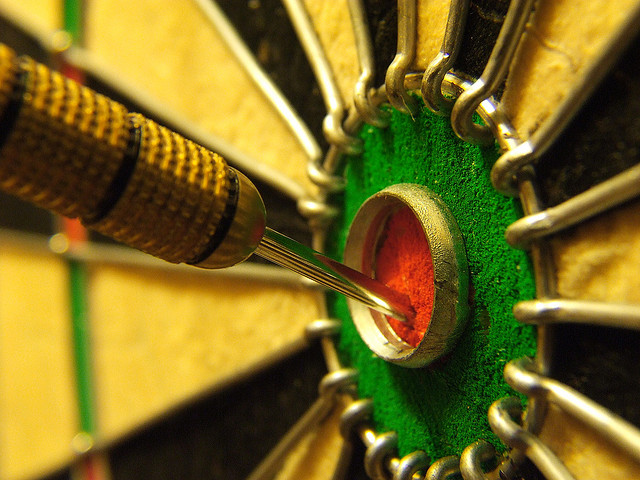 Dart in the bullseye of a dartboard