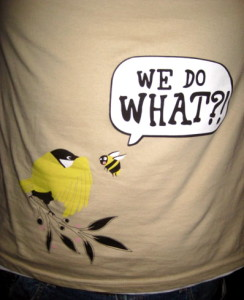 "Tshirt showing a cartoon image of a bird and a bee saying ""we do what?"""