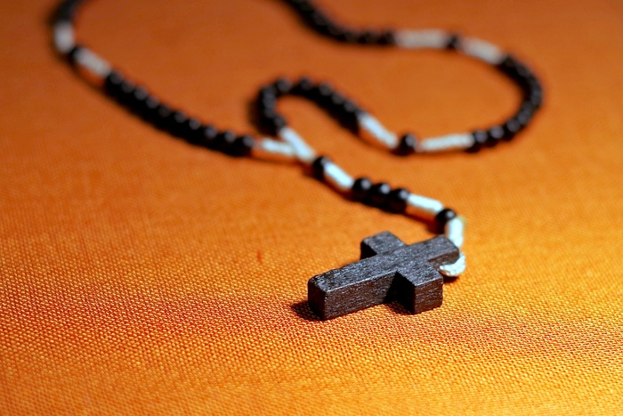 Rosary necklace on table